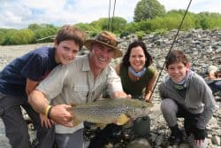 Group of anglers with NZ trout caught in Canterbury