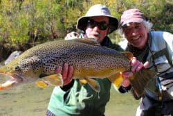 Angler and guide with trout caught in Canterbury NZ river