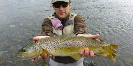 Riccardo with his first New Zealand Trout on a sunny dry fly day